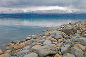 Looking across Lake Pukaki to the snow covered Ben Ohau range, Mackenzie District, Canterbury, South Island, New Zealand.