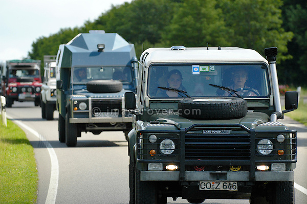 Germany, Land Rover Classic Club 2005. Line up of Land Rover Defenders lead by Victoria Meißner. --- No releases available. Automotive trademarks are the property of the trademark holder, authorization may be needed for some uses.