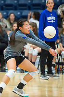 NWA Democrat-Gazette/CHARLIE KAIJO Rogers High School opposite hitter Allie Stephens (15) digs the ball during the girl's volleyball game on Thursday, October 12, 2017 at Bentonville West High School in Centerton.