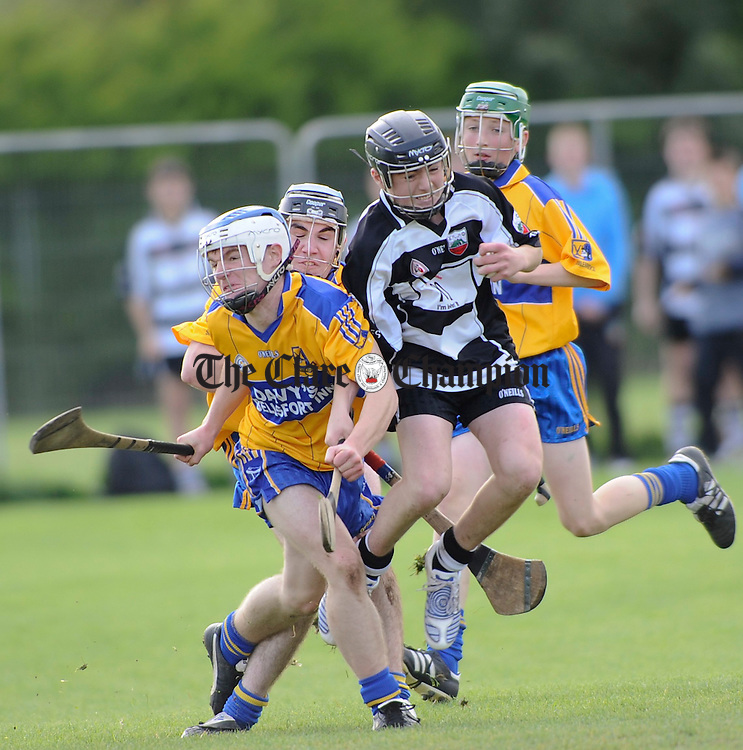 Clarecastles Joseph Barry ships a shoulder from Sixmilebridge's Darragh Mc Namara during their U15A hurling final at Newmarket on Fergus. Photograph by John Kelly.