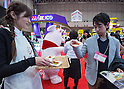 March 3, 2015, Chiba, Japan - A picture released on March 4, 2015 shows a visitor (R) trying a USA pork sample at the USA booth area during the 40th annual International Food and Beverage Exhibition (FOODEX JAPAN 2015). Some 2,977 exhibitors from 79 nations participate in what is known to be the largest food and beverage exhibition in Asia. 75,000 buyers which include wholesalers, food service companies, and distributors are expected to attend FOODEX which runs from March 3-6. (Photo by AFLO)