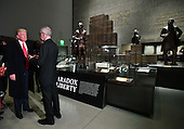 """United States President Donald Trump visits the Smithsonian National  Museum of African American History and Culture in Washington, DC on February 21, 2017.  The """"Paradox of Liberty"""" exhibit at right shows President Thomas Jefferson and other American leaders with slaves, each brick being a slave.   <br /> Credit: Kevin Dietsch / Pool via CNP"""