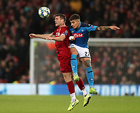 27th November 2019; Anfield, Liverpool, Merseyside, England; UEFA Champions League Football, Liverpool versus SSC Napoli ; James Milner of Liverpool and Giovanni Di Lorenzo of SSC Napoli compete for a header  - Editorial Use