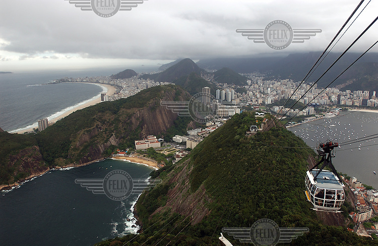 View towards the city and Copacabana beach from a cablecar on the Sugar Loaf mountain.Photo: Dermot Tatlow/Panos Pictures/Felix Features