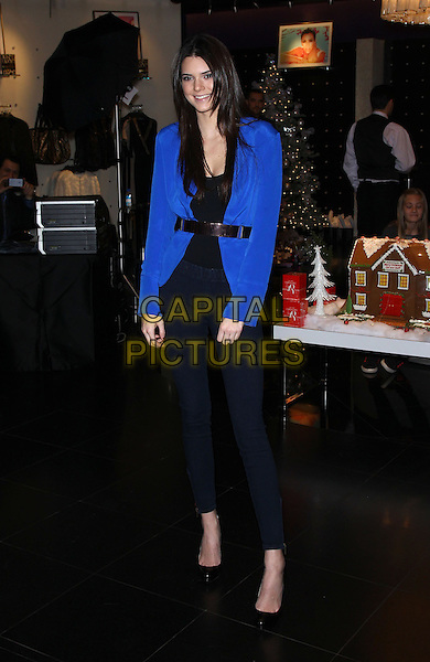 Kendall Jenner.Kendall and Kylie Jenner make an appearance at Kardashian Khaos at The Mirage Hotel and Casino, Las Vegas, NV, USA, 15th December 2012..Full length blue blazer  jacket black  jeans  top shoes silver belt .CAP/ADM/MJT.© MJT/AdMedia/Capital Pictures.