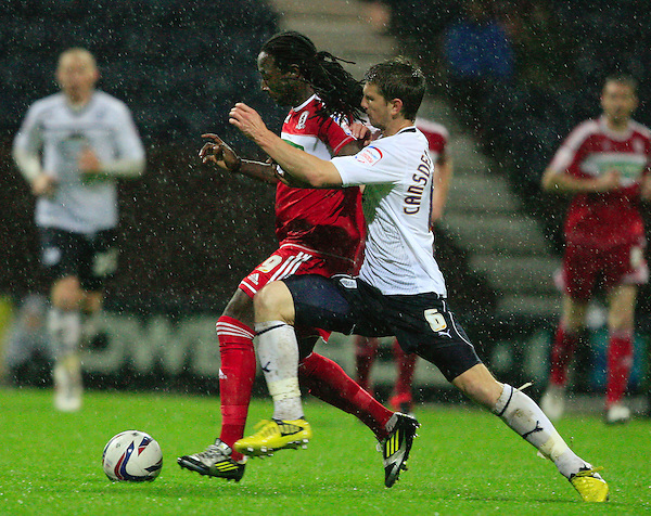 Preston North End's Shane Cansdell Sherriff and Middlesbrough's Marvin Emnes challenge for the ball..Football - Capital One Cup Third Round - Preston North End v Middlesburgh - Tuesday 25th September 2012 - Deepdale - Preston. .¬