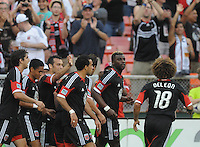 D.C. United defender Brandon McDonald (4) celebrates with teammates his scores in the 15th minute of the game.  D.C. United defeated The New England Revolution 3-2 at RFK Stadium, Saturday May 26, 2012.