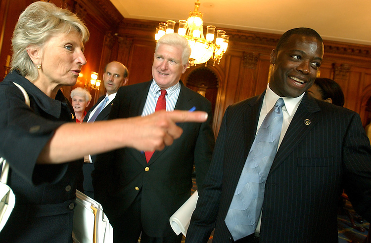 Former Redskin Darrell Green talks with Reps. Jim Moran, D-Va., and Jane Harman, D-Calif., after meeting with Moran on behalf of the Wolf Trap Foundation for the Performing Arts' Education Programs.  Green and other Wolf Trap officials met with members from N. Virginia and Maryland to discuss funding for the programs.