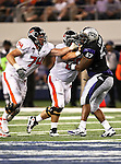 Oregon State Beavers offensive linesman Burke Ellis #74 and TCU Horned Frogs defensive tackle Cory Grant #57 battle it out during the game between the Oregon State Beavers and the TCU Horned Frogs at the Cowboy Stadium in Arlington,Texas. TCU defeated Oregon State 30-21.