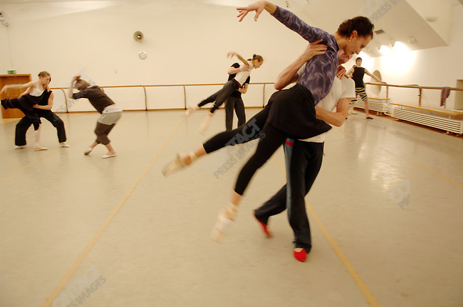 """Dancers from the Bolshoi theatre rehearsed the new ballet """"Misericors' to be premiered by the Bolshoi with its British choreographer Christopher Wheeldon (left) in a rehearsal room in the Bolshoi Theatre, Moscow, Russia, January 25, 2007"""