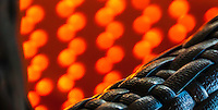 Abstract Photography of coloured lights cast from the sun onto an orange fabric.