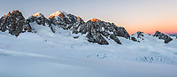 Sun rises on second highest peak of Southern Alps, Mount Tasman 3497m in centre with Mt. Lendenfeld 3194m and Mount Haast 3114m on left and Torres Peak 3160m on right, Westland Tai Poutini National Park, West Coast, UNESCO World Heritage, New Zealand, NZ