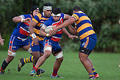 Vini Iosua tries to fight his way past Sione Faletau. Counties Manukau Premier Club Rugby game between Patumahoe and Ardmore Marist, played at Patumahoe on Saturday July 9th 2016.<br /> Ardmore Marist won the game 33 - 24 after leading 18 - 12 at halftime. Photo by Richard Spranger.