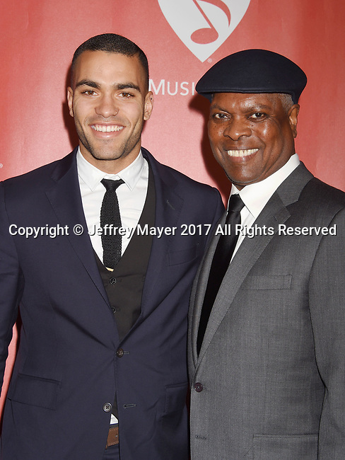 LOS ANGELES, CA - FEBRUARY 10: Musicians Booker T. Jones (R) and son Ted Jones attend MusiCares Person of the Year honoring Tom Petty at the Los Angeles Convention Center on February 10, 2017 in Los Angeles, California.