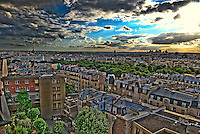 Paris Landscape/Cityscape.  High Dynamic Range Photo.  Shot from private terrace in Montmartre. Eiffel Tower, Arc deTriomphe, La Defense, and more is captured.  HDR created using 3 exposures,combined in Photomatrix.