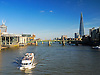 A view down the Thames to the east from the Millennium Bridge with a passenger boat heading towards us and a good view of the Shard and Tower Bridge in the distance. It's all in there.<br />