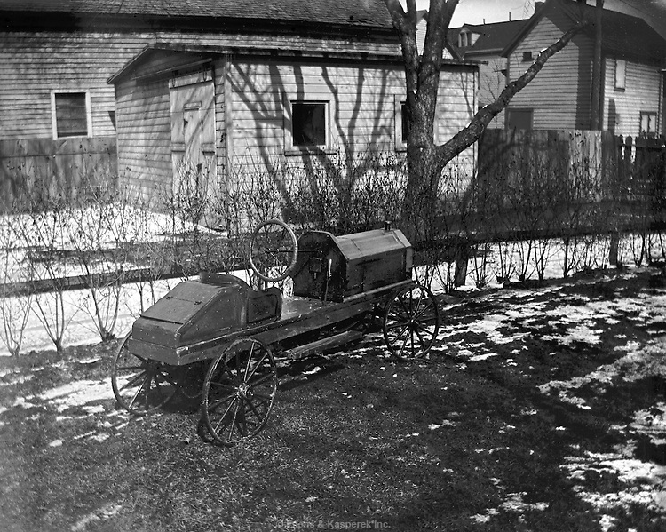 A home-made toy automobile parked in Cleveland neighborhood. @ 1913  FK_01