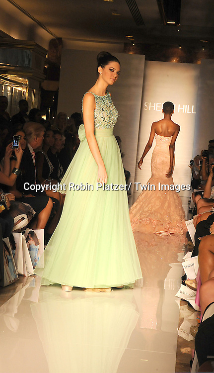 Kendall Jenner models in  the Sherri Hill Spring 2012 Fashion Show on September 7, 2012 at Trump Tower in New York City.