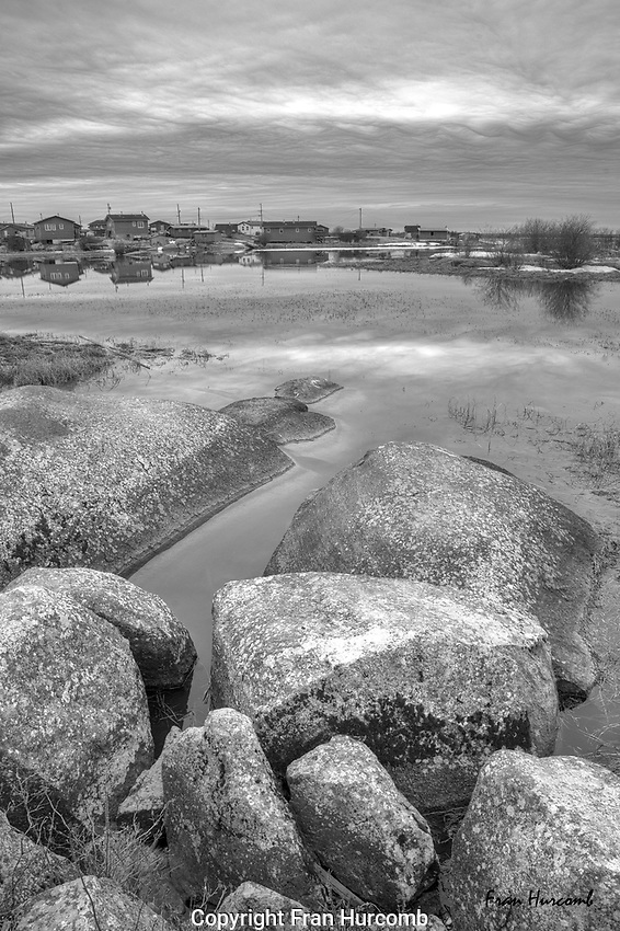 Rocks on the shoreline Bechoko. Black and white