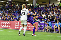 Orlando, FL - Saturday March 24, 2018: Orlando Pride defender Carson Pickett (16) clears the ball while pressured by Utah Royals Gunnhildur Jonsdottir (23) during a regular season National Women's Soccer League (NWSL) match between the Orlando Pride and the Utah Royals FC at Orlando City Stadium. The game ended in a 1-1 draw.