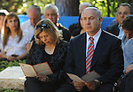 Israel's Prime Minister Benjamin Netanyahu and his wife Sarah, during a memorial ceremony for his brother Yonatan at Mount Herzl military cemetery in Jerusalem on Sunday, June 28, 2009. Yonatan Netanyahu was killed while leading the 1976 raid to rescue hijacked Israeli hostages from Entebbe, Uganda.<br /> Photographer: Ahikam Seri