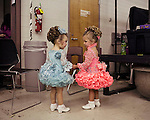 Sophia (left), 2, finds a new friend backstage at The Big Trophy Pageant, Vidalia, Georgia.