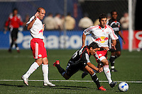 DC United midfielder (10) Christian Gomez gets tripped up by Red Bulls midfielder (13) Clint Mathis. The New York Red Bulls defaeted D. C. United 1-0 in an MLS regular season match at Giants Stadium, East Rutherford, NJ, on July 22, 2007.