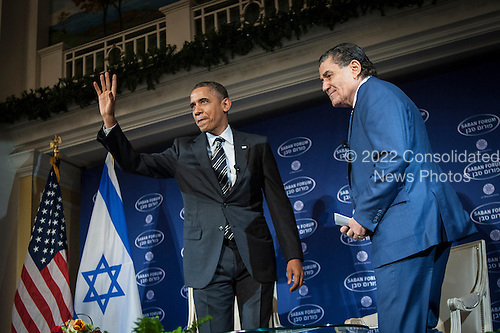 United States President Barack Obama arrives with Saban Forum Chairman Haim Saban at the 10th annual Saban Forum, &quot;Power Shifts: U.S.-Israel Relations in a Dynamic Middle East&quot; at the Willard Hotel on December 7, 2013 in Washington, DC. Obama defended the nuclear agreement with Iran and took questions from the audience. <br /> Credit: Pete Marovich / Pool via CNP