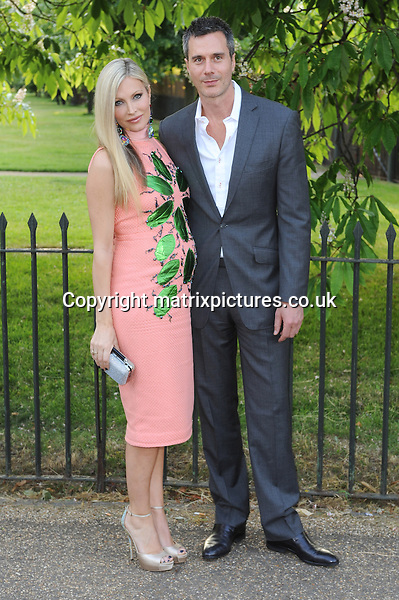 NON EXCLUSIVE PICTURE: PAUL TREADWAY / MATRIXPICTURES.CO.UK<br /> PLEASE CREDIT ALL USES<br /> <br /> WORLD RIGHTS<br /> <br /> Pregnant American former Caprice Bourret and her partner Ty Comfort attending the annual Serpentine Gallery Summer Party, in London's Kensington Gardens.<br /> <br /> 27th JUNE 2013<br /> <br /> REF: PTY 134404