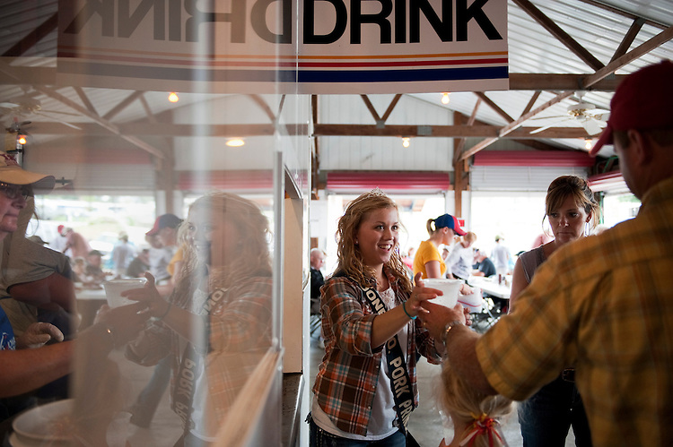 UNITED STATES - AUGUST 16:  Theresa Fitzgerald, 17, Boone County Pork Princess, serves drinks at the Iowa Pork Producers Association pavilion at the Iowa State Fair in Des Moines, Iowa.  (Photo By Tom Williams/Roll Call)