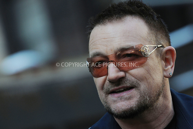 WWW.ACEPIXS.COM . . . . .  ....March 3 2009, New York City....Bono at the temporary re-naming of a section of 53rd Street 'U2 Way' in Manhattan on March 3 3009 in New York City.....Please byline: KRISTIN CALLAHAN - ACEPIXS.COM.... *** ***..Ace Pictures, Inc:  ..tel: (212) 243 8787..e-mail: info@acepixs.com..web: http://www.acepixs.com
