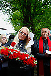LONDON, ENGLAND, 22 May ,2014.  Julia Stevenson (centre) prepares to lay a wreath to mark the first anniversary of the murder of Fusilier Lee Rigby near his Woolwich barracks.