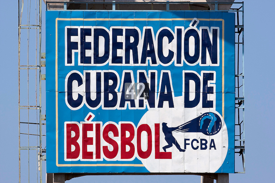 15 February 2009:  The logo of the Cuban federation of Baseball is seen in the stadium during a training game of Cuba Baseball Team for the World Baseball Classic 2009. The national team is pitted against itself, divided in two teams called the Occidentales and the Orientales. The Orientales win 12-8, at the Latinoamericano stadium, in la Habana, Cuba.