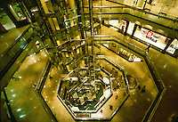Abstract view of elevators and shops in a shopping mall.