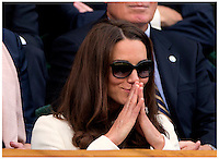 Catherine Duchess Of Cambridge attending the Mens Final of The All England Tennis Championships, Wimbledon. Kate Middleton Wore a white jacket and dress by Joseph...Tel: 07515 876520.e mail: kelvin@kisforkate.com