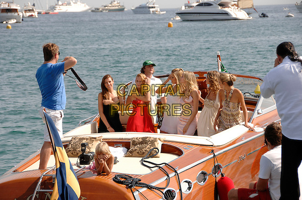 """PETRA NEMCOVA & GIRLS.""""Fashion TV Supermodels 2008"""" calendar launch at the 60th International Cannes Film Festival, Cannes, France.  .May 24th, 2007.full length water boat dock white summer dress photographer  .CAP/PL.©Phil Loftus/Capital Pictures"""