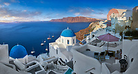 Traditional blue domed Greek Orthodox church of Oia, Santorini ( Thira ) Island, Greece.