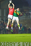 Cork's Michael O'Leary is first to the ball over Colm Moriarty of Kerry in the Munster U21 Football Championship Final held on Wednesday night in Pairc Ui Rinn Cork.