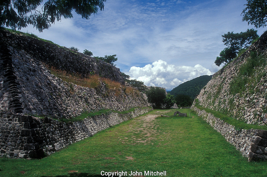 The north ballcourt at the ruins of Xochicalco near Cuernavaca, Morelos, Mexico. Xochicalco flourished between 700 and 900 AD and was once one of the most important ciities in Mesoamerica. Xochicalco was declared a UNESCO World Heritage Site in 1999.