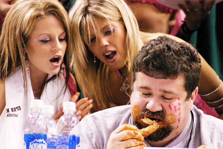 "Mo Green and his Wingettes at the 13th annual Wing Bowl, held in Philadelphia on February 4, 2005 at the Wachovia Center.<br /> <br /> The Wing Bowl is a competitive eating event in which eaters try and down the most hot wings in 30 total minutes in front of a crowd of 10,000 plus people.  The real show however is all around the eaters, from the various scantily clad women, known as ""Wingettes"", that make up competitors' entourages to the behavior of the fans themselves."