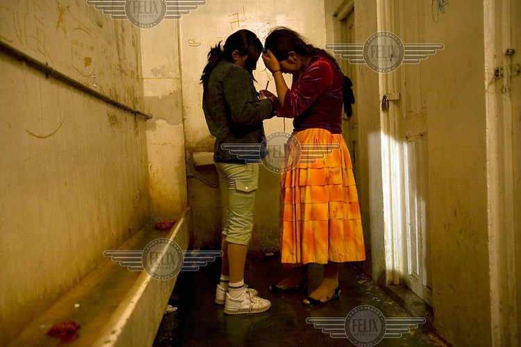 17 year old wrestler Alicia Flores (fighting name), Patricia Kaly (real name) signs an autograph after a fight at the Multifuncional building in El Alto. Patricia is a Cholita, a wrestler of native Aymara descent. When Cholitas fight they wear traditional costume.