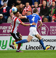 Lincoln City's Lee Angol vies for possession with Macclesfield Town's Neill Byrne<br /> <br /> Photographer Chris Vaughan/CameraSport<br /> <br /> Vanarama National League - Lincoln City v Macclesfield Town - Saturday 22nd April 2017 - Sincil Bank - Lincoln<br /> <br /> World Copyright &copy; 2017 CameraSport. All rights reserved. 43 Linden Ave. Countesthorpe. Leicester. England. LE8 5PG - Tel: +44 (0) 116 277 4147 - admin@camerasport.com - www.camerasport.com