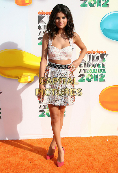Selena Gomez.2012 Nickelodeon Kids' Choice Awards held at the Galen Center, Los Angeles, California, USA, 31st March 2012..full length bra cropped crop top midriff skirt hand on hip pink shoes  bustier white black silver .CAP/ADM.©AdMedia/Capital Pictures.