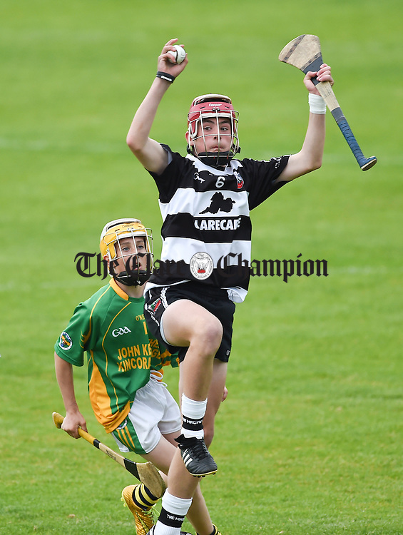 Darragh Healy of Clarecastle in action against Conor Phelan of Broadford during their U-14A hurling county final at Cusack park. Photograph by John Kelly.
