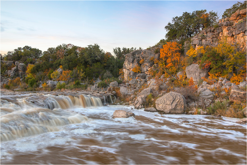 The trees were alive with Autumn color at Pedernales Falls State Park. Just days before, heavy rains fell across central Texas, filling the Hill Country creeks and streams with more water than they are used to. Here, the Pedernales River is overflowing, creating some very nice waterfalls to capture with beautiful oranges, golds, and reds of November.