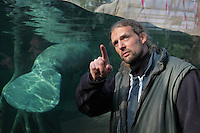 Alexis Lecu, head veterinarian, in front of the manatee tank (a manatee's tail is visible on the left) in the Great Glasshouse in the Zone Guyane of the new Parc Zoologique de Paris or Zoo de Vincennes, (Zoological Gardens of Paris or Vincennes Zoo), which reopened April 2014, part of the Musee National d'Histoire Naturelle (National Museum of Natural History), 12th arrondissement, Paris, France. Picture by Manuel Cohen