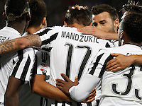 Calcio, Serie A: Fiorentina vs Juventus. Firenze, stadio Artemio Franchi, 24 aprile 2016.<br /> Juventus&rsquo; Mario Mandzukic, center, back to camera, is hugged by teammates after scoring during the Italian Serie A football match between Fiorentina and Juventus at Florence's Artemio Franchi stadium, 24 April 2016. <br /> UPDATE IMAGES PRESS/Isabella Bonotto
