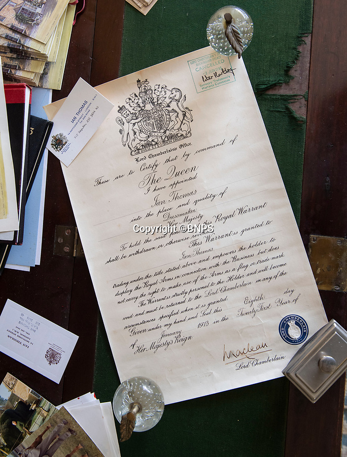 BNPS.co.uk (01202 558833)<br /> Pic: PhilYeomans/BNPS<br /> <br /> Thomas's Royal Warrant.<br /> <br /> A remarkable 'time warp' Royal archive amassed by the Queen's dressmaker has been found inside his old country home.<br /> <br /> The late Ian Thomas was a dress designer for members of the Royal Family, including Her Majesty, for over 30 years.<br /> <br /> As an apprentice he worked alongside the renowned fashion designer Norman Hartnell on creating the Queen's coronation dress in 1953.<br /> <br /> His archive includes embroidered samples of the gown worn by Elizabeth II for the historic ceremony in Westminster Abbey that was broadcast to millions.<br /> <br /> Mr Thomas also designed outfits for the Queen Mother and Princess Margaret.