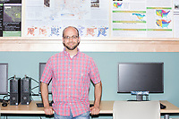 Justin Solomon is the organizer of the Metric Geometry and Gerrymandering Group (MGGG) hackathon and an Assistant Professor in MIT's Computer Science and Artificial Intelligence Laboratory (CSAIL) and Department of Electrical Engineering and Computer Science (EECS).  He is seen here at the Data Lab in the Tisch Library at Tufts University in Medford, Massachusetts, USA, on Thurs., Aug. 10, 2017.  The hackathon is part of the first in a series of Geometry of Redistricting workshops put on by the MGGG. Academics, Geographic Information Systems (GIS) professionals, and legal professionals worked together to build tools useful in analyzing voting district data around the country.