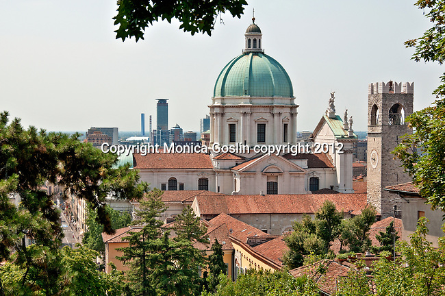New Cathedral in Brescia, Italy with the modern city in the background